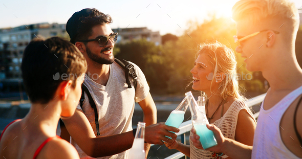Young energetic group of people having fun - Stock Photo - Images