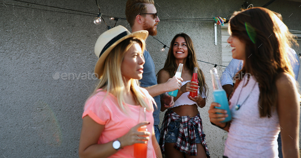 Friends having fun outdoors and are happy - Stock Photo - Images