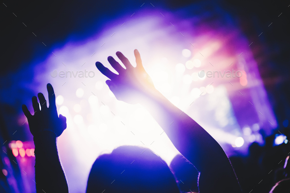 Cheering crowd at concert enjoying music performance - Stock Photo - Images