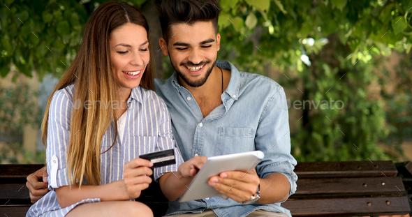 Happy couple doing shopping on internet - Stock Photo - Images