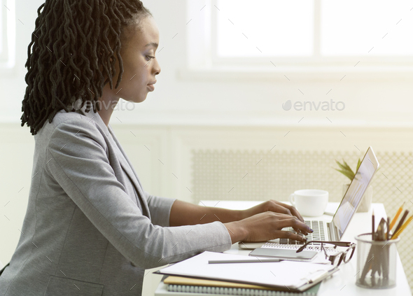 Young Lady Working On Laptop Sitting At Workplace, Side View - Stock Photo - Images