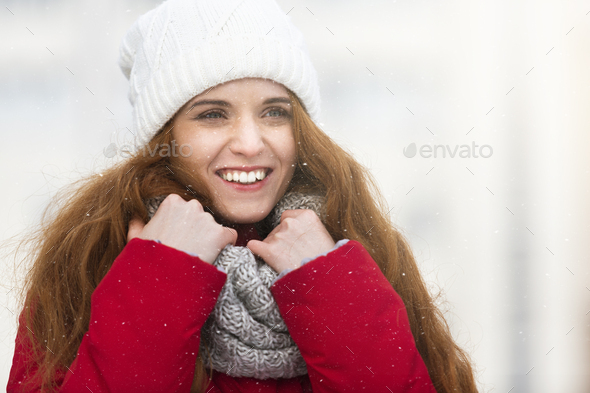 Portrait of beautiful smiling girl in winter city - Stock Photo - Images