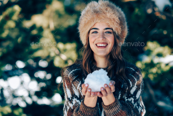 Young woman enjoying the snowy mountains in winter - Stock Photo - Images