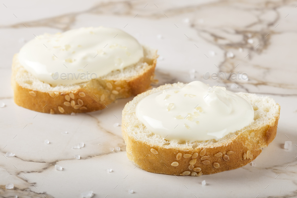 Sesame bagel with cream cheese - Stock Photo - Images