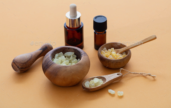 Chios mastic tears and essential oil on orange color background - Stock Photo - Images