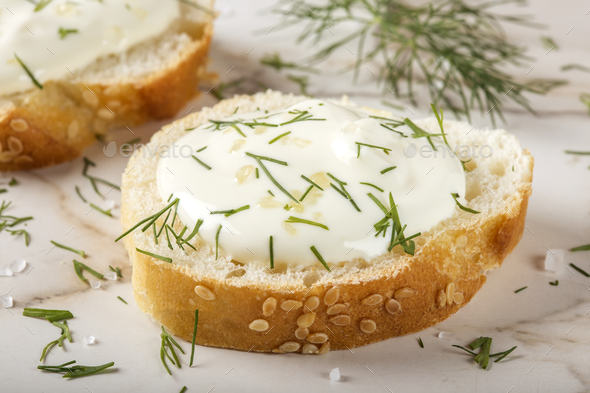 sesame bagel with cream cheese and dill - Stock Photo - Images