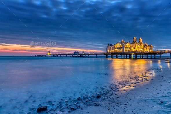 Dawn at the beautiful sea pier of Sellin - Stock Photo - Images