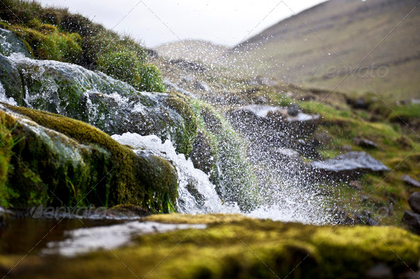 Splashing water of waterfall on Faroe Islands - Stock Photo - Images