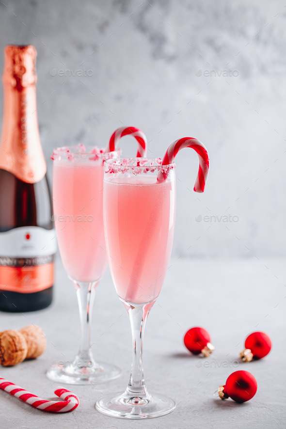 Festive Christmas drink Peppermint Bark Mimosa cocktail with champagne or prosecco and candy cane - Stock Photo - Images