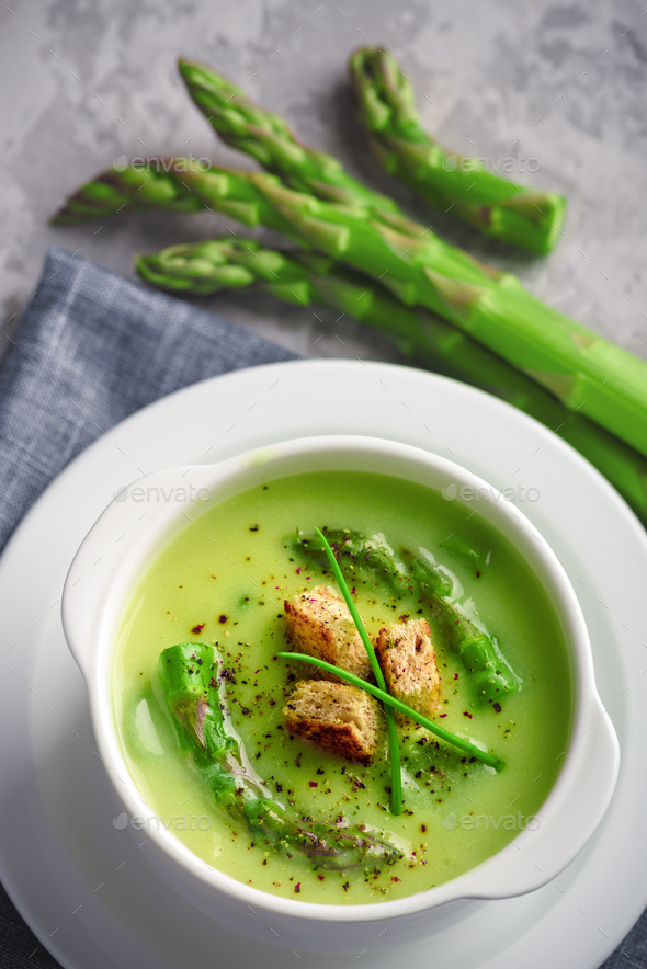 Asparagus soup in white bowl - Stock Photo - Images