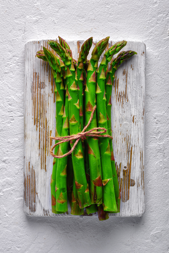 Green asparagus sprout on wooden plate - Stock Photo - Images