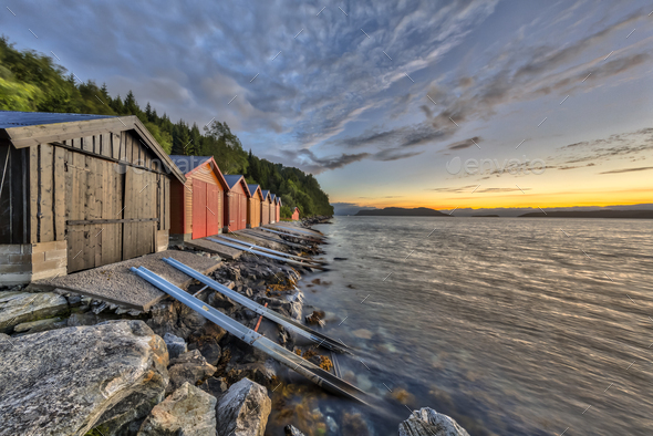 Sunset with Colorful Boathouse in Norwegian fjord - Stock Photo - Images