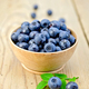 Blueberries in a wooden bowl on the board - PhotoDune Item for Sale