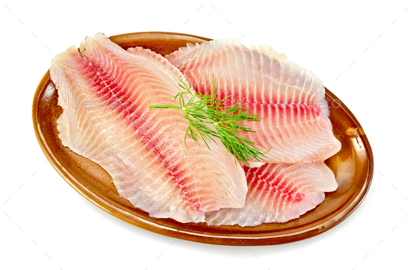 Fillets tilapia in a pottery - Stock Photo - Images