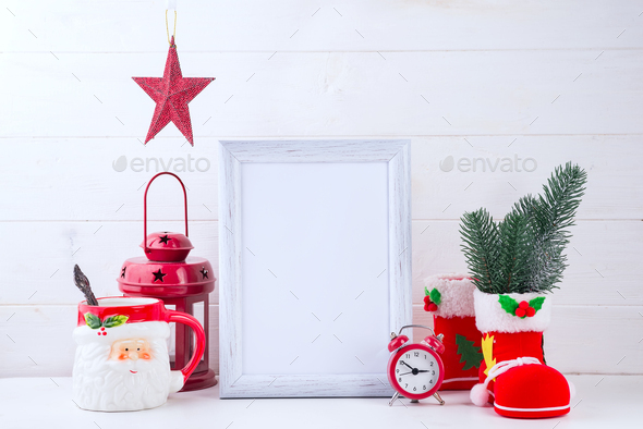 Photo mock up with white frame, Poinsettia in a flowerpot and red lantern on white wooden background - Stock Photo - Images