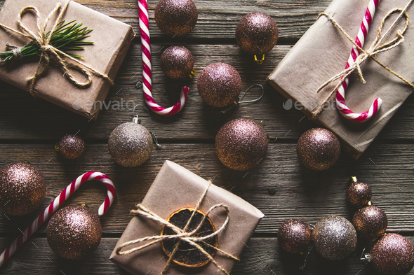 Christmas background with fir tree, present box and decorations on wooden background. Top view - Stock Photo - Images