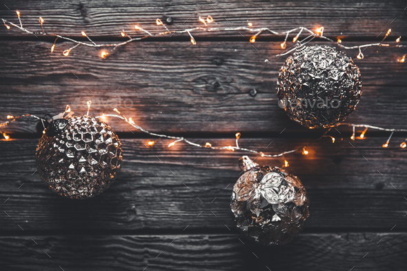 Christmas or New Year background. Vintage Christmas tree toy decoration balls and light garland - Stock Photo - Images