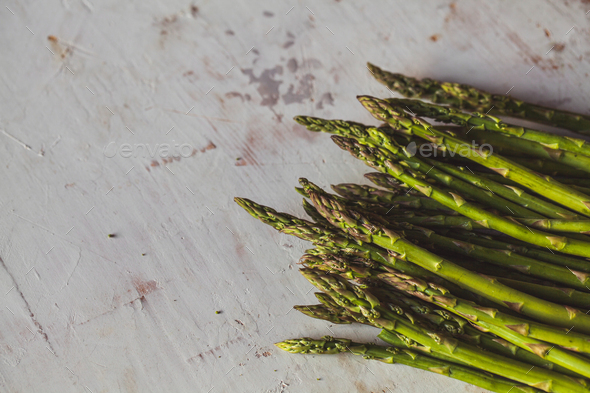 Fresh green spring asparagus on a wooden background. Asparagus season. Wholesome healthy food - Stock Photo - Images