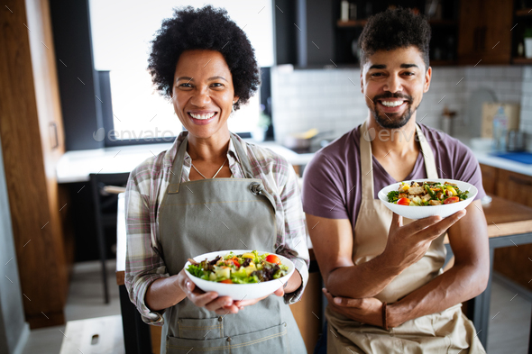 Portrait of happy chefs in kitchen. Healthy food, cooking, people, kitchen concept - Stock Photo - Images