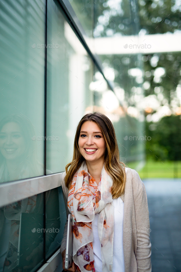 Portrait of beautiful young happy woman smiling - Stock Photo - Images