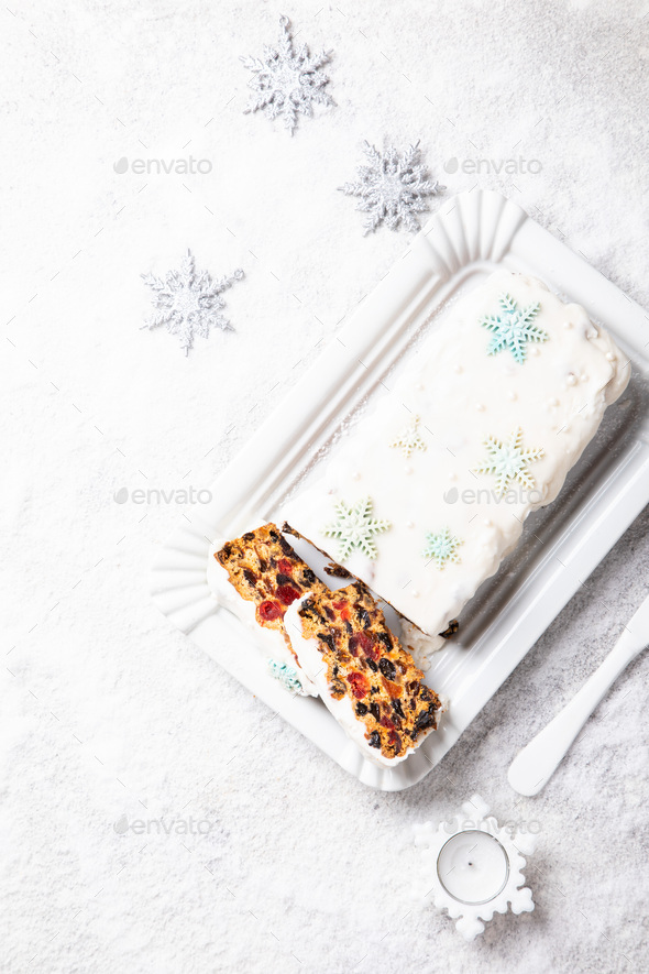 Christmas Fruit Cake, Pudding on snowy background . New Year pas - Stock Photo - Images