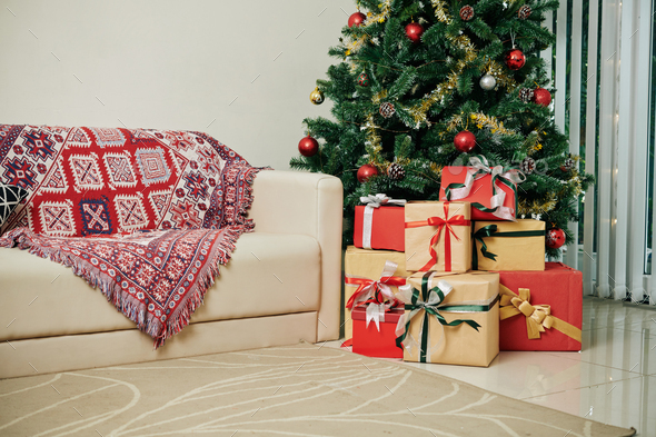 Christmas presents under tree - Stock Photo - Images
