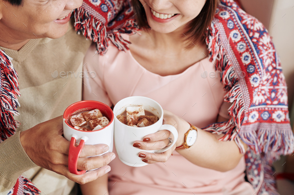 Couple drinking sweet cocoa - Stock Photo - Images