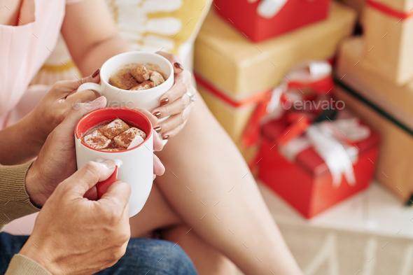 Couple drinking hot chololate - Stock Photo - Images