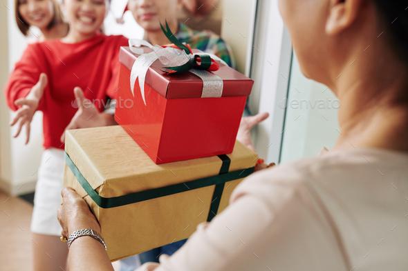 Woman bringing Christmas presents - Stock Photo - Images