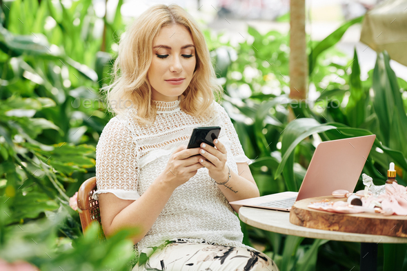 Business lady checking her phone - Stock Photo - Images