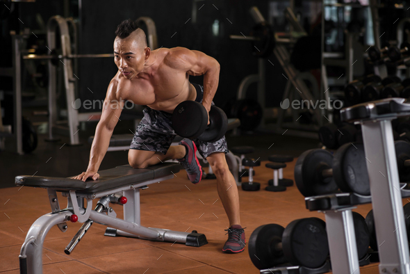 Young man exercising with dumbbells - Stock Photo - Images