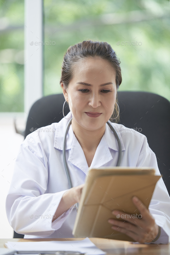 General practitioner at work - Stock Photo - Images
