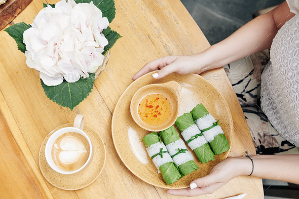 Plate with spring rolls and sauce - Stock Photo - Images