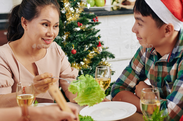 People talking at Christmas dinner - Stock Photo - Images