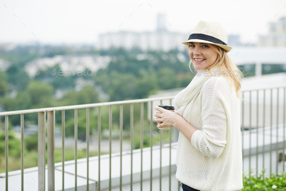 Lovely young woman with coffee cup - Stock Photo - Images