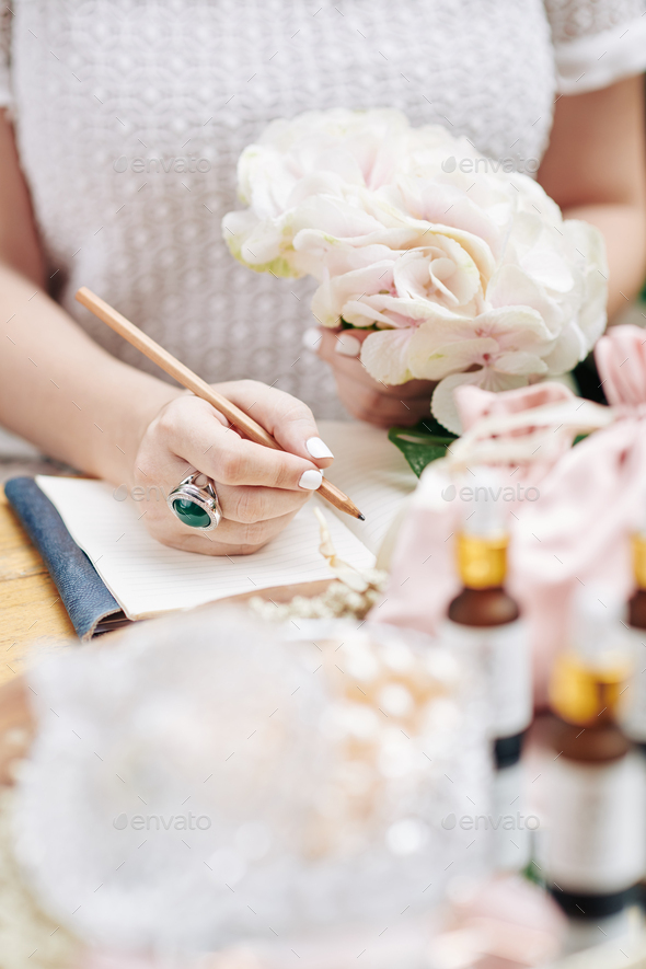 Woman writing ideas for new cosmetics - Stock Photo - Images
