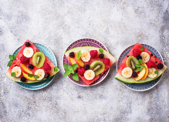 Watermelon pizza with fruit and berries - Stock Photo - Images