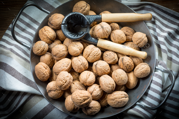Whole nuts and nutcracker. - Stock Photo - Images