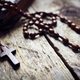 Rosary beads and crucifix cross on holy bible - PhotoDune Item for Sale