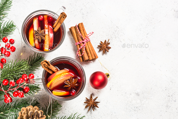 Mulled wine with christmas decorations on white - Stock Photo - Images