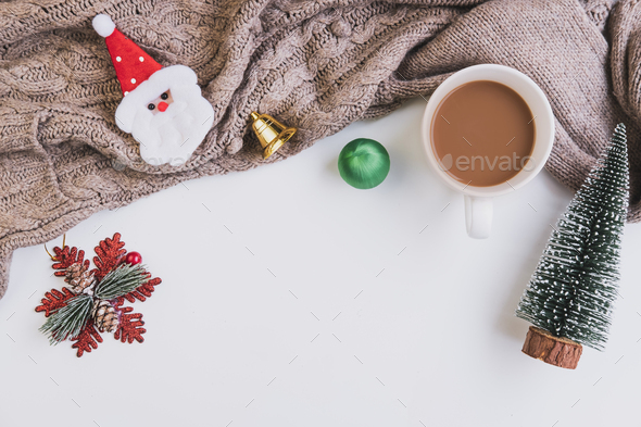 Cup of coffee with christmas ornament and sweater with copy space, Top view - Stock Photo - Images