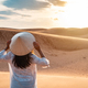 Young woman traveler looking sunset at red sand dunes in Vietnam, Travel lifestyle concept - PhotoDune Item for Sale
