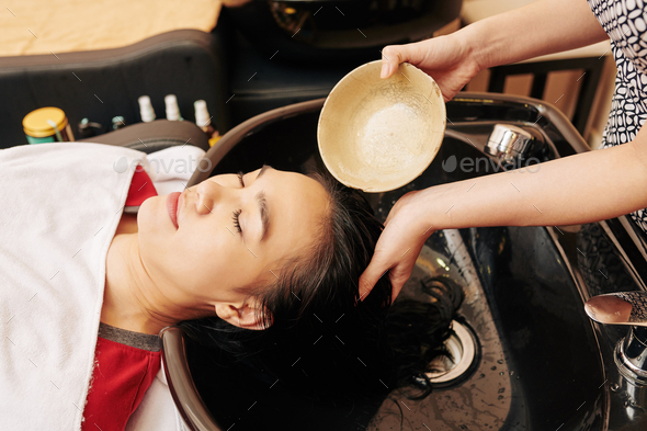 Rinsing hair with treatment - Stock Photo - Images