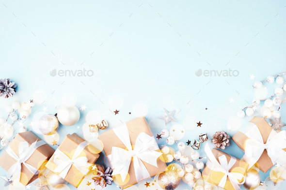 Christmas Gift Boxes with Decorations on Blue Background. - Stock Photo - Images