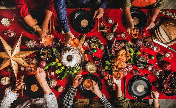 Christmas or New Year party. Flat-lay of people feasting at decorated table - Stock Photo - Images