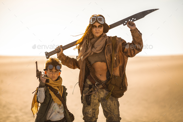 Post-apocalyptic Woman and Boy Outdoors in a Wasteland - Stock Photo - Images