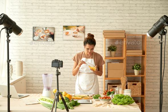Food blogger cooking - Stock Photo - Images