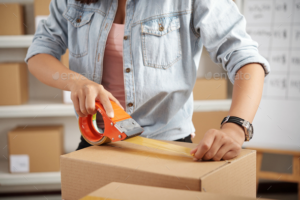 Applying tape on package - Stock Photo - Images