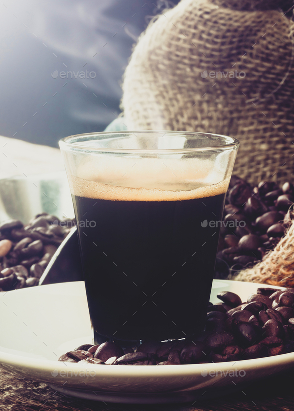 Espresso coffee in glass cup with coffee beans. - Stock Photo - Images