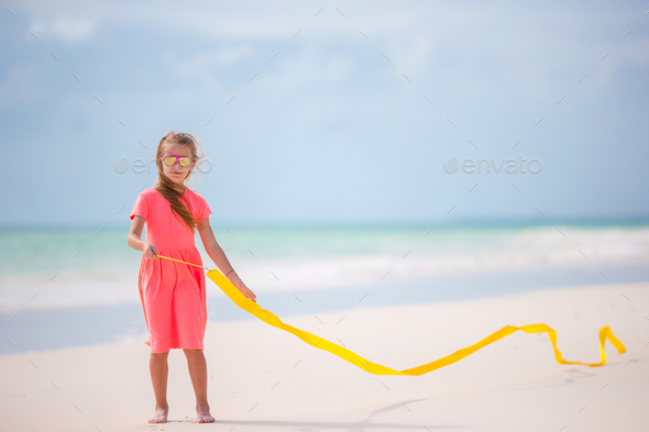 Adorable little girl dancing with with gymnastic ribbon - Stock Photo - Images